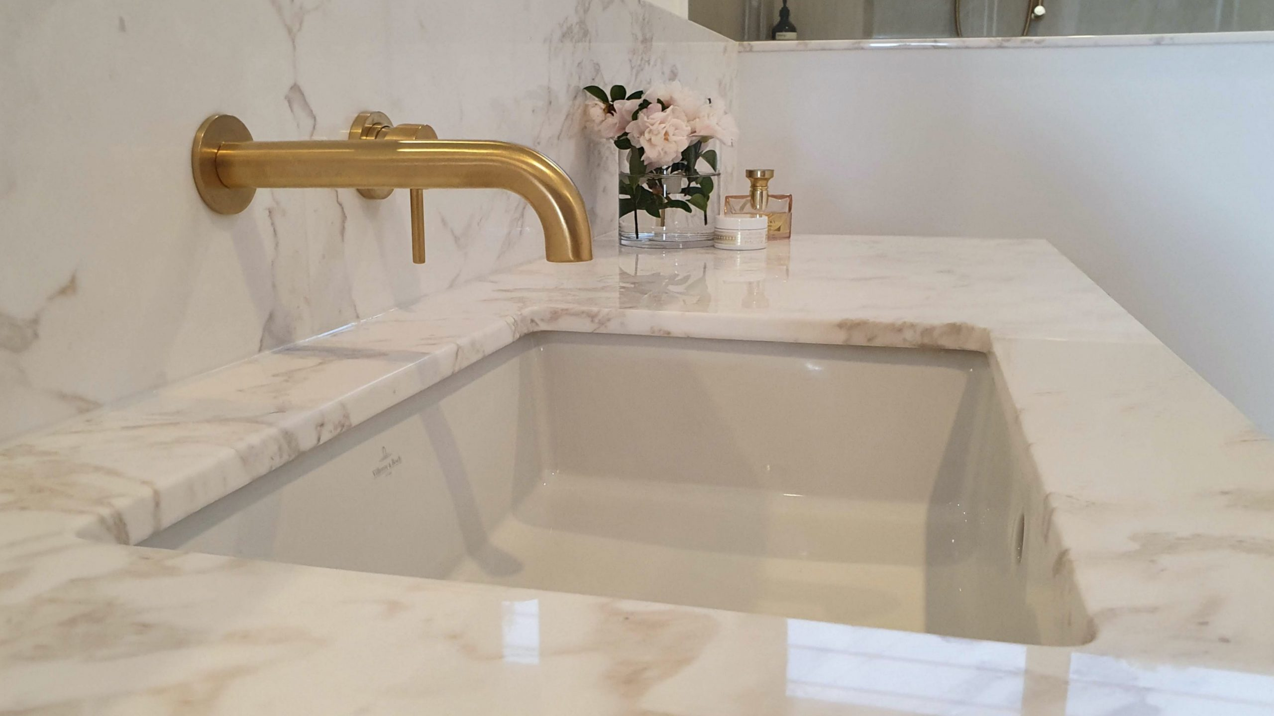 Contemporary brass tap and marble sink. Design Lennox Head